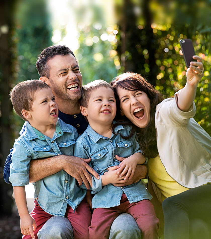 Parents With Children Taking Selfie